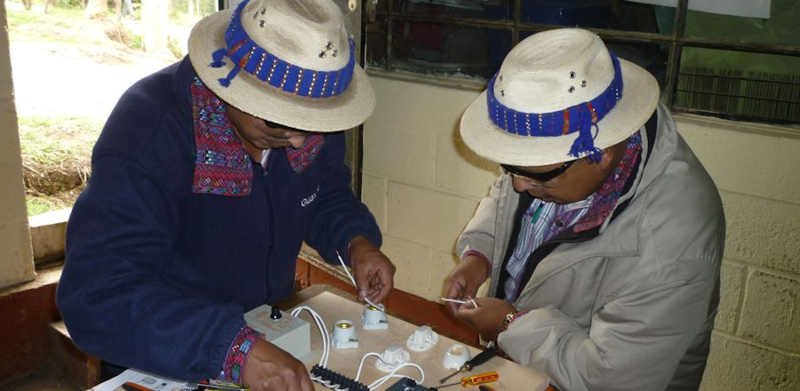IMDI's Director, Natalio and Pedro put together the practice solar energy system.jpg